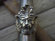 Hey, I found this really awesome Etsy listing at https://www.etsy.com/listing/79648567/gargoyle-ring-in-sterling-silver