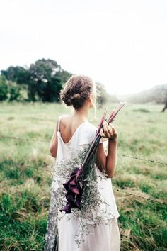 Ultimate bridal inspiration - An elegant floaty dress, a bohemian up-do matched with deep purple irises for the bridal bouquet. Perfect for a low key country wedding.