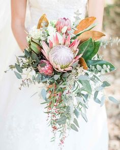 Summer fall wedding bouquet with protea magnolia leaves pepperberry and eucalyptus Tropical Wedding Bouquets, Protea Wedding, Fall Wedding Bouquets, Flower Bouquet Wedding, Floral Wedding, Bridal Bouquets, Protea Bouquet, Eucalyptus Bouquet, Protea Flower