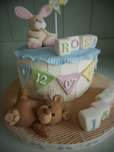 Fondant rabbit, teddy bear & pinwheel christening cake by Little Aardvark Cakery (www.littleaardvarkcakery.com)