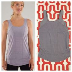 Lululemon Run For Your Life tank Lavender Grey (stock photo is best representation of color). Great preloved condition. Loose fitting with built in medium support bra - does not include inserts. 4-way stretch power Luxtreme with Silverescent mesh. Cinch able drawcord at hem. No trades. No PayPal. lululemon athletica Tops Tank Tops