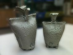 Altered wheel thrown vessels.  Pinch top, add little feet and create an opening at top.  Could be a great Mom's day gift idea.