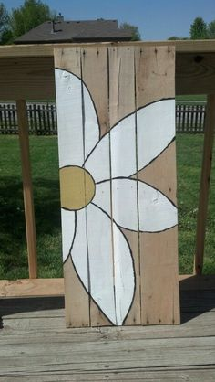 Pallet flower this is what I want to do , but a complete square to paint and hang on our barn....Amish quilt like!!!