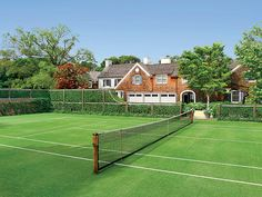The home's grass tennis court.