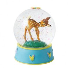Beautiful Bambi in a globe decorated with butterflies with green/blue sparkles when shook. This water ball has been lovingly hand painted helping to bring the
