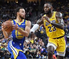 Stephen Curry of the Golden State Warriors drives against LeBron James of the Los Angeles Lakers during their preseason game at T-Mobile Arena on October 2018 in Las Vegas, Nevada. The Lakers. Get premium, high resolution news photos at Getty Images Stephen Curry, Lebron James, Basketball Season, Basketball Legends, Nba Basketball, Nba Sports, Sports News, Sports Betting, Sports Games