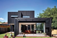 The addition references the rectilinear forms of the existing part of the house.