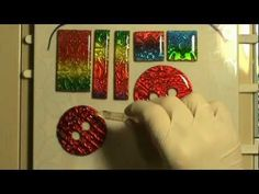 Faux Dichroic by Irina Romanov.Though...I wouldn't call this faux dichroic. It's embossed foils covered with resin. But the video is very well done and if this is a new technique for you, then it's well worth watching.