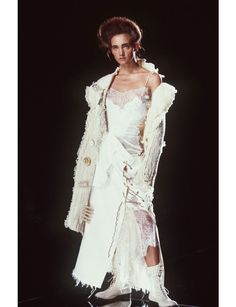 From Claudia Schiffer in corseted Chanel dress, to Laetitia Casta striding out for Yves Saint Laurent dressed entirely in feathers and Lily Cole, who famously appeared in a super-sized Christian Dior skirt, stunning wedding gowns are the pinnacle of couture expertise and the highlight of each show. For brides-to-be, Vogue.fr looks back over our favorite haute couture styles.