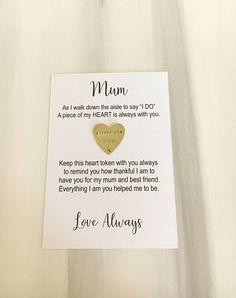 A sweet gift to give your dad or mum on the morning of your wedding. Available in copper or brass and stamped simply I love you dad or mum Comes on the card shown and can be detached for your dad or mum to pop in their purse / wallet and carry with them always or could be left on the