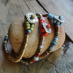 SMELT | Hello Pretty. Buy design.This quirky set of 3 single button bracelets are made from Kenyan Giriama beads, glass and brass and finished with a handcrafted pewter button. Length:  18cm each