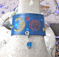 Custom fit, and tooled and painted leather cuff bracelet with sun, moon and beaded dangle. #handtooled #SunMoon #leathercuff #bead