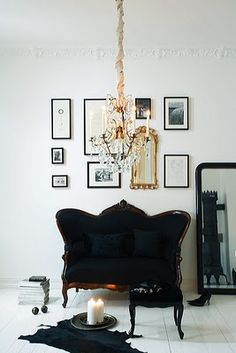 Kind of love that antique couch with black upholstery.