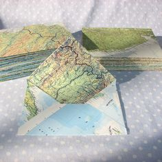 Handmade envelopes made of maps from PeaPickins on Etsy.