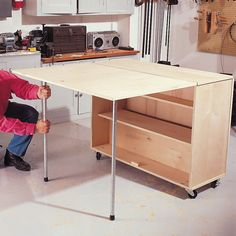 to Build a Compact Folding Workbench with Storage This is a great space saver for a small garage! Folding Workbench: The Family HandymanThis is a great space saver for a small garage! Folding Workbench: The Family Handyman