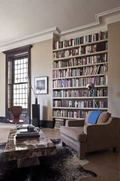 A simple floor to ceiling bookshelf highlights the height of the generous ceilings. Idea for my music/library room?
