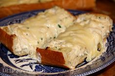 Catch of the Day Crab Bread - Crabmeat mixed with a tangy blend of sour cream and mayo, layered on French bread with cream cheese and Monterey Jack cheese. Cut into slices and serve hot for a great appetizer!