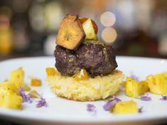 Goat Sliders On Scallion Rice Cakes Recipe - Genius Kitchen Rice Cake Recipes, Rice Cakes, Goat Meat, Serving Plates, Baking Sheet, Sliders, Lamb, Goats, Cooking