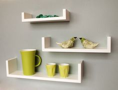 I will have these ! Modern, clean, white u-shaped shelves. Great for displaying special books and ornaments for little one. Place up high so little hands can't touch.