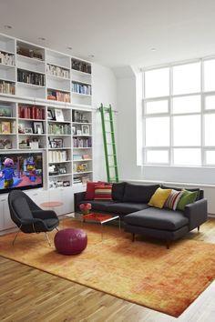 Suzie: Jennifer Eisenstadt - Playroom with full wall of white built-ins bookshelves, green ...