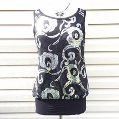 """NWOT Karen Kane Black Top Size Medium with Sequins Host Pick for the Romantic Style Party 5-11-15 Chosen by @whatsleft❤️ NWOT Karen Kane Lined Black Top Size Medium with Silver Sequins Mint Condition since it has never been worn. 60% Polyester, 35% Rayon, 5% Spandex. Lining is 94% Rayon, 6% Spandex. Contrast is 90% Rayon and 10% Spandex. Hand Wash Cold. Mannequin is a 36-24-36. Measurements laying flat: Bust: 18"""", Length 28"""". No Trades, PayPal or Low Ball Offers Karen Kane Tops"""