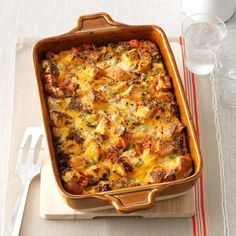 Tomato, Sausage & Cheddar Bread Pudding Recipe -This savory dish is the perfect excuse to have bread pudding as THE meal, not merely afterward as dessert. — Holly Jones, Kennesaw, Georgia