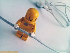 Old school LEGO astronaut exploring really dirty headset!
