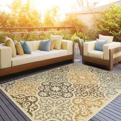 Add a pop of pattern to the patio or define space in the den with this chic rug, showcasing a stylish medallion motif.