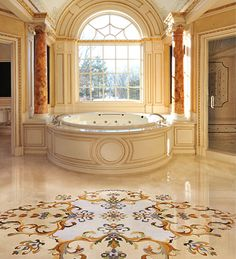 Aalto Design's Rococco marble medallion floats harmoniously in the center of this grand master bath.