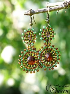 handmade bead embroidery earrings in earth tones, seed beads in brown and greens with brass ear hook