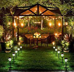 Lighting: garlands of light in a patio garden