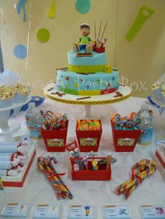 Handy Manny Party, I like the red buckets for the candy. Mr. Lopart's candy store...