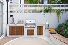 Backyard Landscaping Ideas – This small patio space is ready for a party with its built-in BBQ and plenty of seating - This modern landscaped garden has a bespoke outdoor kitchen with a bbq, counter space and storage. Small Patio Spaces, Small Outdoor Kitchens, Modern Outdoor Kitchen, Outdoor Kitchen Cabinets, Outdoor Living, Kitchen Island, Small Garden Kitchen, Modern Spaces, Bbq Island