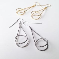 Looping unique geometrical earrings in silver door LauraEssayie