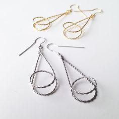 Looping unique geometrical earrings in silver door LauraEssayie