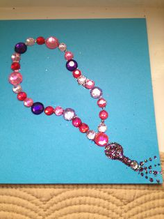 Ramadan craft--tasbih out of gems. So fun for the kids Eid Crafts, Ramadan Crafts, Ramadan Decorations, Crafts For Kids, Decoraciones Ramadan, Islam For Kids, Japanese Paper, Mother And Father, Diy Paper