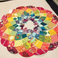 Chris Jurd's Ancient Dahlia pattern in scrappy rainbow of Anna Maria Horner fabrics. From procrasticraft.com