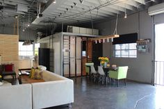 I really, really love this converted auto shop house.