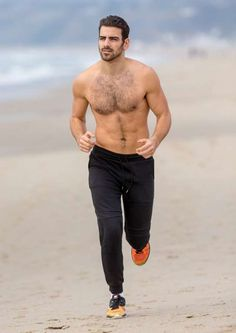 Celebrity beach cruising 2016: America's Next Top Model 2015 winner and first deaf contestant Nyle Dimarco ran on the beach in Sant... - VIPix/Splash News