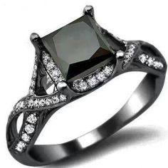 Black and White Diamond Ring. Fabulous!  This is a cute promise ring! It's unique and I love the black like the one Carrie has on Sex and the City 2