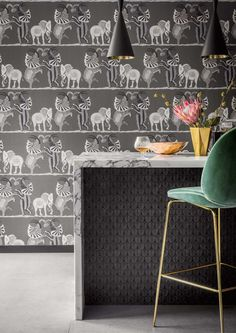 Our magnificent Safari Dance Wallpaper by Cole & Son forms part of the new Ardmore Collection. This beautifully patterned wallpaper features a trio of hand-drawn elephants