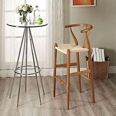 The Modway Amish Wooden Bar Stool will add some unique seating to your home. Constructed from sturdy beechwood, this chair features an hourglass shape, a footrest on the lower level, and a seat made of paper rope.