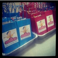 DIY caillou goodie bags . Printed this picture off of the internet and glued to these paper bags I bought at walmart.