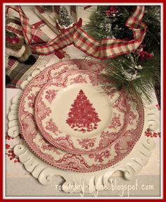 I have these christmas plates Love the plaid with the red transfer ware