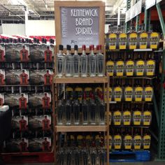 KBI display rack loaded with Kennewick Brand Vodka and Fine Gin