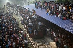 An overcrowded train approaches a station in Dhaka, November 16, 2010. Third Prize Daily Life Single, Andrew Biraj, Bangladesh, Reuters. #