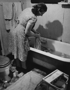 1950s Housewife Doing Laundry in Bathtub. We've come a long way!