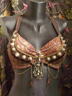 Chains like this.  Tribal Fusion Bellydance Bra by siphonophoria