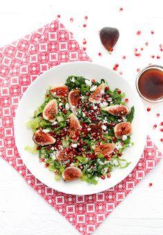 A plate fo fig and pomegranate salad