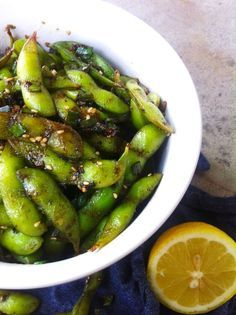 EASY EDAMAME WITH GARLIC, SOY, & LEMON -- substitute soy sauce w/liquid amino to cut down on the sodium. even healthier!!
